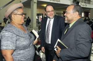Justice Minister Senator Mark Golding (centre) shares a light moment with Justice David Batts and Carol Palmer, permanent secretary in the Justice Ministry before the start of Sunday's commemoration service for the National Restorative Justice Week 2014 at Emmanuel Apostolic Church on Slipe Road in Kingston. (Photo: Bryan Cummings/Jamaica Observer)