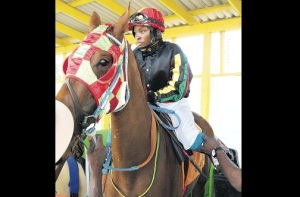 Georgina Sergeon atop Good Life, her first ride after returning from a two-year absence due to injuries received from a fall. (Photo: Garfield Robinson/Jamaica Observer)