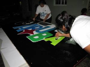 Members of the Aruba Community Group get to work on some beautiful art for Earth Hour.