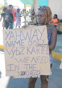 "A supporter of Mr. Vybz Kartel outside the court house in downtown Kingston on Thursday does not believe in God, but suggests that the deejay (""World Boss"") is all you need to get by in life."