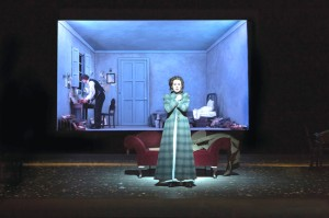 The art direction included frames (sometimes asymmetrical and tilted) to create more intimate settings on the huge stage. Here in the final act, Charlotte gets ready to go and find Werther, who is already rather ominously contemplating a box of pistols in his room. This is a piercing moment when she stands outside in the darkness, fearful for Werther, while he moves about his room.