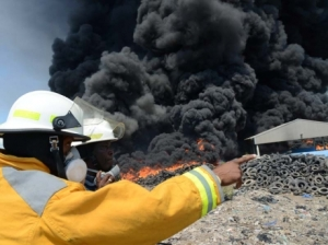 Firemen seek to control the  fire at Riverton City dump on Sunday, March 16. (Photo: Rudolph Brown/Gleaner)
