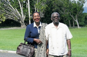Norma Walters being escorted by her husband, retired Custos of St Ann Radcliffe Walters during an inspection of the grounds of the Seville Great House prior to her installation as Custos of the parish.