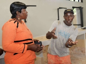 A fish vendor talks to Mayor of Lucea Shernet Haughton during a visit to the market last year. (Photo: Claudia Gardner/Gleaner)
