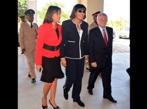 Prime Minister Portia Simpson Miller enters the Montego Bay Convention Centre, flanked by Hospiten's chairman, Dr Pedro Luis Cobiella (right), and State Minister in the Ministry of Industry Investment and Commerce Sharon Ffolkes Abrahams.-Photo by Claudia Gardner