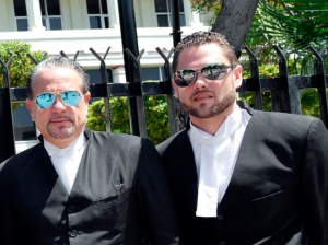I suppose they consider these sunglasses very cool: the grandstanding defense team of Tom Tavares Finson (left) and son Christian. (Photo: Gleaner)