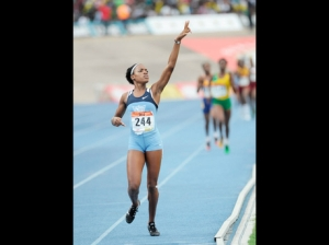 Edwin Allen High's Marleena Eubanks salutes her supporters as she crosses the line to win the Class One 800m final in 2:06.51 at the ISSA/GraceKennedy Boys and Girls' Championships at the National Stadium yesterday. - Photo by Ricardo Makyn/Gleaner