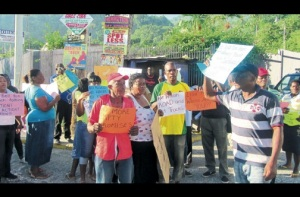 Parry Town residents demanding water in their pipes. (Photo: Renae Dixon/Jamaica Observer)