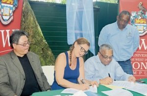 Founder and chair of Alligator Head Marine Lab Francesca von Habsburg, and Principal of the University of the West Indies, Mona, Professor Archibald McDonald sign the partnership agreement for the establishment of Alligator Head Marine Lab and seven projects designed to restore the marine environment in the area. Witnessing the signing are Director of the Fisheries Division at the Ministry of Agriculture and Fisheries Andre Kong (left) and Director of the Centre for Marine Science, Professor Dale Webber. (Photo: Naphtali Junior/Jamaica Observer)