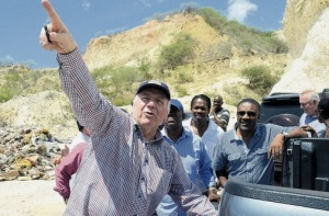 Energy World International's Managing Director and Chairman Stewart Elliot points to where the Liquefied Natural Gas storage tank will be located when the company begins construction of its electricity generating project soon. Elliot was on a tour of the Cane River area of East Rural St Andrew yesterday with a group that included (from left) Commissioner of Police Owen Ellington, Member of Parliament for East Rural St Andrew Damian Crawford and Minister of Science, Technology, Energy and Mining, Phillip Paulwell. Energy World was recently granted a licence by the Office of Utilities Regulation for the supply of additional generating capacity to the national grid. (Photo: Joseph Wellington/Observer)