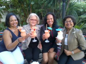 Celebrating: Jean Lowrie-Chin (far right) and other founding members of ProComm. (Photo: Twitter)
