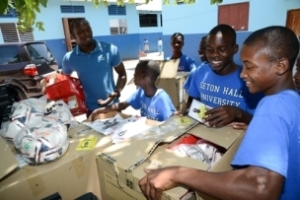 The boys at Alpha Boys' School enjoy the donated sports gear. (Photo: Jamaica Observer)