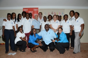 Judine Hunter (front row-second from left), Programme Manager, Special Needs, Digicel Foundation, Father Garvin Augustine ,Executive Director of Mustard Seed Community  International, and Samantha Chantrelle, Executive Director of the Digicel Foundation join the staff of MSC for a group shot following the opening of Care Plus Centre of Excellence on Wednesday, March 26. (Photo: Digicel Foundation)