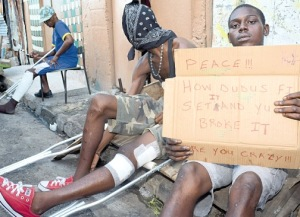 These men, some of the gunshot victims in the ongoing feud in West Kingston, yesterday join residents of the area to stage a protest, calling for an end to the ongoing violence. (Photo: Lionel Rookwood/Jamaica Observer)