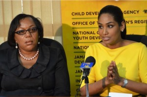 Minister of Youth and Culture, Hon. Lisa Hanna (right), makes a point while addressing a press briefing at the Ministry, in St. Andrew, where she provided an update on the latest reports on child abuse. Beside the Minister is Chief Executive Officer of the Child Development Agency Mrs. Rosalee Gage-Grey. (Photo: JIS)
