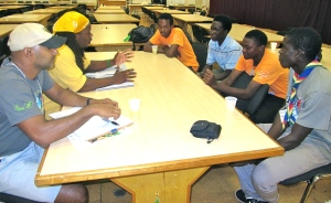 Scott Johnson (in yellow, left) talks to a group of Grenadian Boy Scouts at last year's