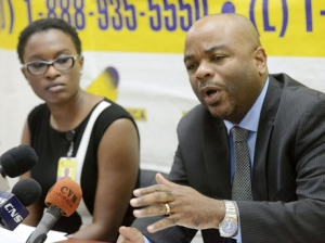 Terrence Williams, head of the Independent Commission of Investigations (INDECOM), speaks with members of the media while Kahmile Reid, senior communications officer of INDECOM, looks on. (Photo: Rudolph Brown/Gleaner)