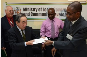 Japanese Ambassador to Jamaica, His Excellency Yasuo Takese hands over cheque to outgoing Commissioner of the Jamaica Fire Brigade, Laurie Williams, at the Ministry of Local Government and Community Development in Kingston, on March 27. Looking on are (from left): Chairman of the Jamaica Fire Brigade, Mr. Jalil Dabdoub Jnr., and Acting Commissioner of the Jamaica Fire Brigade, Errol Mowatt. (Photo: JIS)