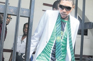 Adijah Palmer (aka Vybz Kartel) dressed up for his court appearance, wearing his old school tie (Calabar High School). Photo: Jamaica Observer)