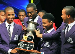 The winning Kingston College team celebrates after Schools Challenge Quiz on television. In the background are Campion College team members, whom they beat by a very narrow margin. (Photo: Jamaica Observer)