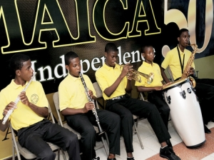 Members of the Alpha Boys' Band play for The Royal Philharmonic Orchestra on their arrival at the Norman Manley International Airport a few years ago. - Winston Sill/Freelance/Gleaner