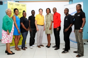 At Friday's launch of the YUTE Lens Support Program:L-R - Mrs Marjory Kennedy, Honorary Consul of Australia to Jamaica, Mrs Sandra Glasgow, Deputy Chair of eMedia Interactive Ltd and Director YUTE Ltd, Mr Joseph Matalon, Chairman, YUTE Ltd, Ms Alicia Glasgow, Executive Director, YUTE Ltd, and Mr. Tyrone Wilson, President and CEO of eMedia Interactive Ltd, share lens time with some participants of the YUTE Lens Support Programme which was launched on Friday, April 25 at the Technology Innovation Centre, UTECH.  The project is a being done in partnership between YUTE Ltd and eMedia Ltd and is funded in part through the Australian High Commission's Direct Aid programme.