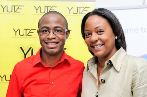 L-R – Tyrone Wilson, President and CEO of eMedia Interactive and Ms Alicia Glasgow, Executive Director of YUTE Ltd, are all smiles at the launch of the YUTE Lens Support Program on Friday, April 25 at the UTECH's Technology Innovation Centre. Through this partnership, 40 YUTE participants will be trained in all aspects of film production. YUTE Lens Support is funded in part by the Australian High Commission through its Direct Aid program and is the second initiative to be launched as part of phase II of the Youth Upliftment Through Employment (YUTE) program.