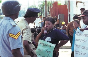 Police in discussion with civilians during the 1999 gas riots. The violent riots motivated the formation of human rights group Jamaicans for Justice. (Photo: Jamaica Observer)