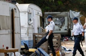 French police inspect an illegal Roma camp in Aix-en-Provence to control and check the identity of its residents on August 19, 2010. France sent dozens of Roma home on flights to Bucharest on Thursday in the first mass repatriation since President Nicolas Sarkozy unveiled a crackdown on crime and immigration with the dismantling of some 300 illegal camps that has been condemned by rights groups. Some 60 Roma left on a chartered plane from Lyon and about a dozen boarded a flight from Paris, the first wave of transfers in a campaign to send 700 people living in squalid camps across France back to Romania and Bulgaria by the end of the month.  REUTERS/Philippe Laurenson  (FRANCE - Tags: SOCIETY POLITICS)