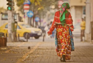 A Romani woman walks on a street in France.