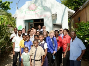 Directors and members of American Friends of Jamaica, including former U.S. Ambassadors Brenda LaGrange Johnson and J. Gary Cooper, with residents at the Rose Town Community Library in Kingston.