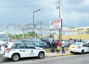 Payless Motors on Maxfield Avenue in Kingston was closed for business yesterday following the murder of its manager, Robert Mendez. (Photo: Joseph Wellington/Jamaica Observer)