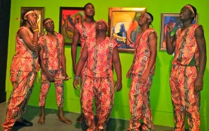Members of the St. Catherine High School drumming troupe strike poses in the art exhibition.