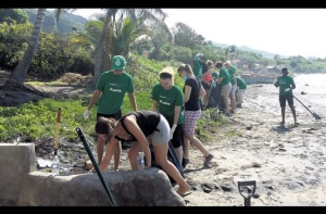 Volunteers from Projects Abroad clean up the Alligator Pond beach. (Photo: Helena Jalkner/Jamaica Observer)