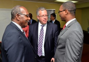 (l-r) Lloyd Wilks, Canadian High Commissioner Robert Ready and Minister of State Arnaldo Brown chat at yesterday's launch of the Diaspora Mapping Project. (Photo: Jamaica Information Service)