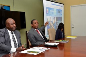 (l-r) Director of Diaspora and Consular Affairs at the Ministry of Foreign Affairs and Foreign Trade Lloyd Wilks; Minister of State Hon. Arnaldo Brown; and Programme Assistant at IOM Rukiya Brown. (Photo: Jamaica Information Service)