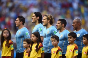 Edinson Cavani, Diego Forlan and team mates sing the national anthem with constricted breath due to tight jerseys. (Photo by Laurence Griffiths/Getty Images)