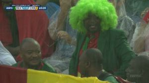 The luminous green wig was dripping wet and his green suit sodden, but this was my Fan of the Day.
