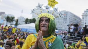 An eccentric Brazilian fan sends up a prayer.