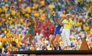 Jennifer Lopez, Brazilian singer Claudia Leitte and someone called Pitbull on stage at the opening ceremony. (Getty Images)