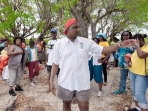 Dr Fritz Pinnock (foreground), executive director of the Caribbean Maritime Institute, addresses the touring party  on Little Goat Island. (Photo: Gleaner)