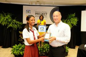 Jodi Morgan receives a prize from Jamaican photographer Ray Chen. (Photo: JN Foundation)