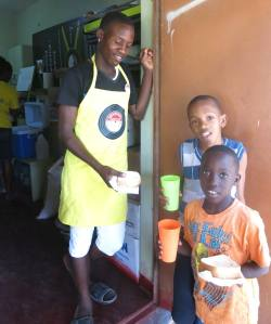Kirkland, a former student at the Trench Town Reading Centre, now working there - providing sustenance. (Photo: Facebook)