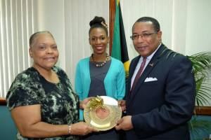 Industry, Investment and Commerce Minister, the Hon. G. Anthony Hylton (right) and JBDC CEO, Valerie Veira are all smiles as they present JBDC Entrepreneur of the Year Award to Lacey-Ann Bartley. The announcement was made recently at the JBDC Small Business Expo (May 22), an official presentation was made to Bartley at the Ministry of Industry, Investment & Commerce. (Photo: Facebook)