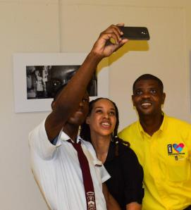 Selfie time! Glenmuir's Carl Simpson takes a photo of himself, Project Officer Amashika Lorne and a representative of the LIME Foundation, one of the co-sponsors, in front of Carl's own photograph - a self-portrait. (Photo: JN Foundation)