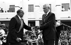 Former Governor General Sir Howard Cooke sworn in by Prime Minister Michael Manley in 1991. Sir Howard died on July 11, 2014. (Photo: Gleaner Archives)