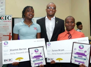 Shantol Barton (left), top Caribbean Secondary Education Certificate student among those who used the EduFocal system to study, and Tyrese Bryan (right), top Grade Six Achievement Test student, pose with their awards and cheque with Gordon Swaby, creator of the study system, during the EduFocal Awards Ceremony held last Thursday. - (Ian Allen/Gleaner)