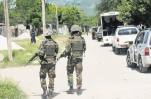 Security forces on patrol in August Town, St. Andrew, where a curfew is in effect. (Photo: Bryan Cummings/Observer)