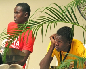 Two members of the Alpha Boys' School Band watch the proceedings intently. You can purchase their very cool T shirts in many sizes and brilliant colors at the Alpha Wear JA Facebook page. They are irresistible! (My photo)