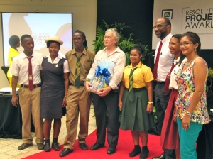 Stuart Reeves (center, holding a basket) with Earl Jarrett, General Manager of the Jamaica National Building Society and students. (My photo)